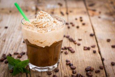 Наклейка Лед кофе со взбитыми сливками в стакане на деревянном столе