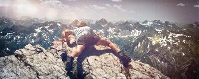 Наклейка Man Scrambling Over Rocks on Mountain Ledge