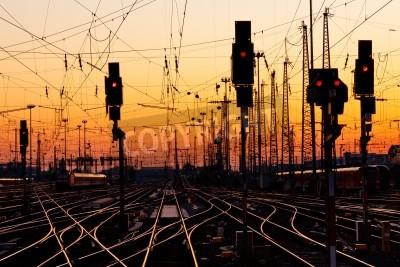 Наклейка Railroad Tracks at a Major Train Station at Sunset.