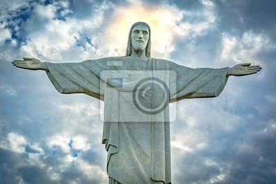 Наклейка Статуя Христа Спасителя под драматического закат небо. Христос Искупитель является арт-деко статуя создатель французского скульптора Пола Ландовски