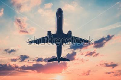 Наклейка реактивный самолет на фоне живописного неба