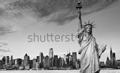 Наклейка photo statue of liberty new york city black and white hi contrast. nyc new york city skyline over Manhattan cityscape midtown. statue of liberty over hudson river in new york city.