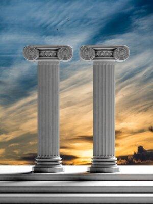 Наклейка Два старинных столбы с фоне закатного неба.