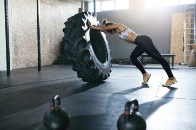 Наклейка Гиревой спорт. Тренировка спортсменки с колесом Crossfit в спортзале